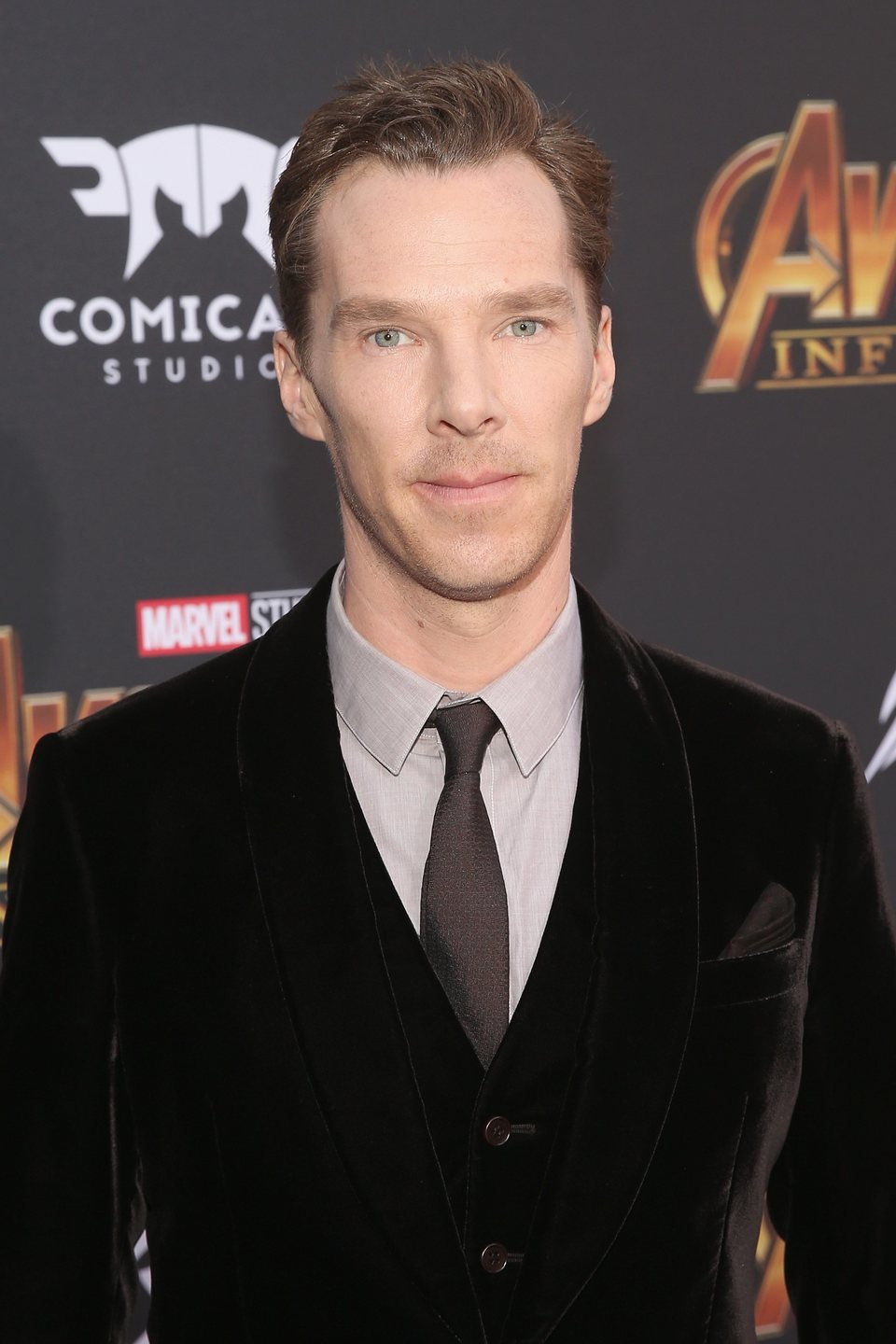 Benedict Cumberbatch poses on the purple carpet at the world premiere of 'Avengers: Infinity War'