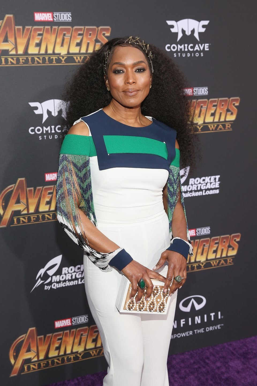Angela Bassett poses on the purple carpet at the world premiere of 'Avengers: Infinity War'