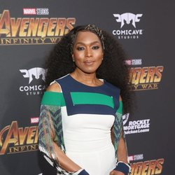 Angela Bassett poses on the purple carpet at the world premiere of 'Avengers: Infinity War'