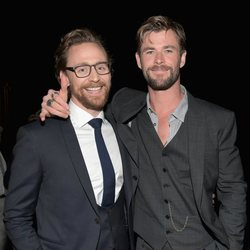 Chris Hemsworth & Tom Hiddleston pose on the purple carpet at the world premiere of 'Avengers: Infinity War'
