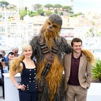 Emilia Clarke, Chewbacca and Alden Ehrenreich attend the premiere of 'Solo: A Star Wars Story' during the 71st Cannes Film Festival