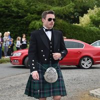 Richard Madden arrives at the wedding of Kit Harington and Rose Leslie